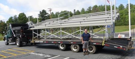 bleachers being transported on a lowbed trailer