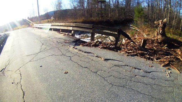 road washing away near bridge