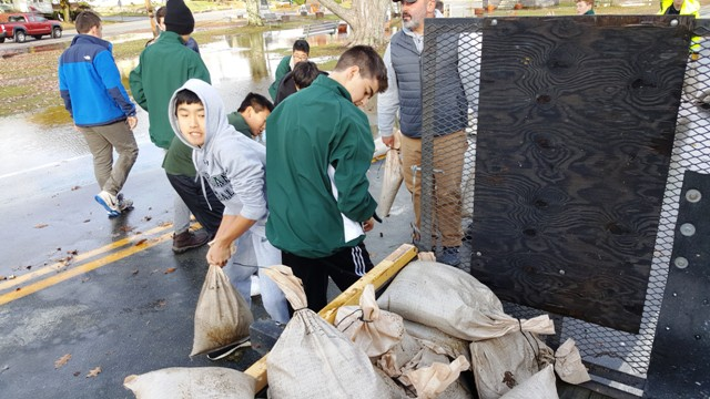 students helping with sandbags
