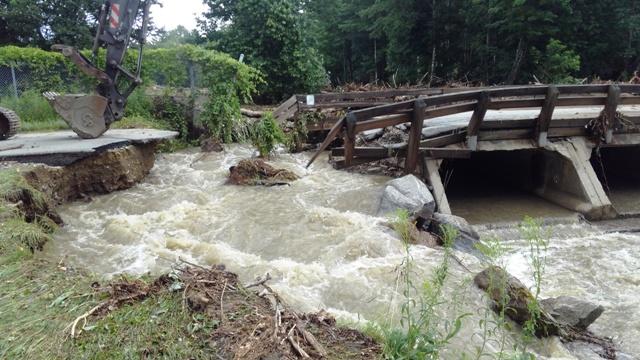 water rushing over bridge