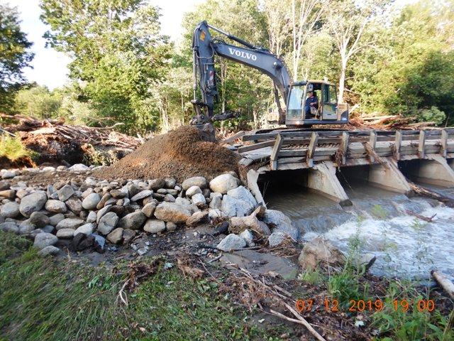 backhoe repairing bridge