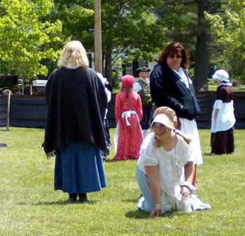students learning colonial games