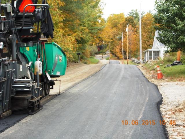 applying pavement to Codfish Hill Rd