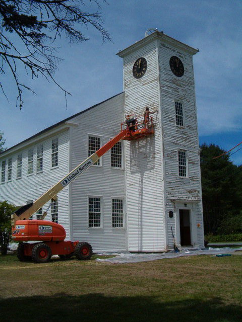 painting the bell tower from a lift