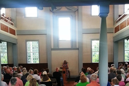 people listening to a meeting house readings author