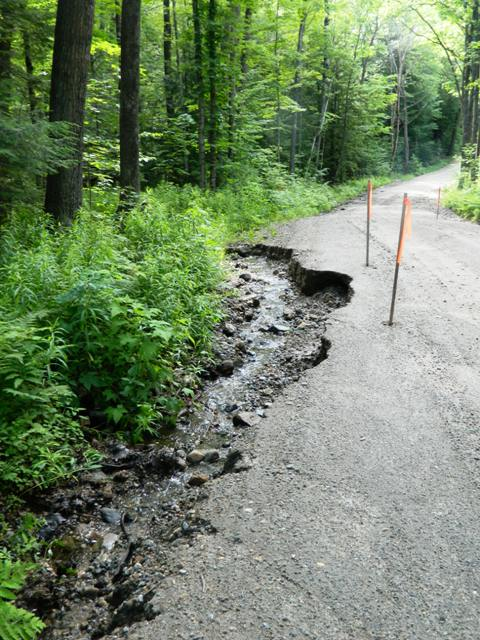 ditch erosion cutting into road