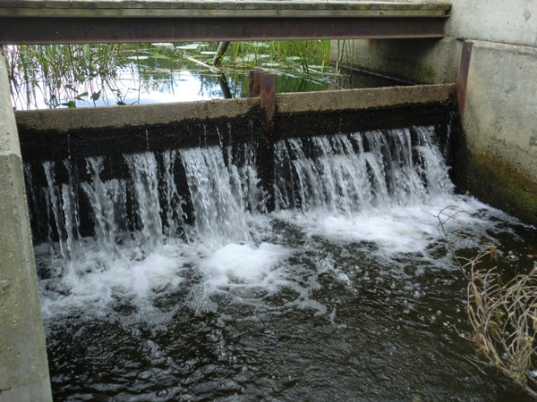 water going over dam